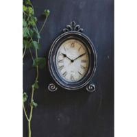 11-Inch Oval Wood Mantel Clock with Feet in Black