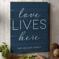Love Lives Here 16-Inch x 20-Inch Wooden Slat Sign