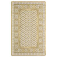 Momeni Newport Tufted 5' x 8' Area Rug in Gold