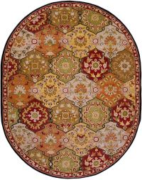 Surya Caesar Floral Medallion 8' x 10' Hand Tufted Oval Area Rug in Brown/Red