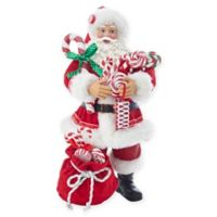 Kurt Adler 10.5-Inch Fabriché™ Santa with Candy and Bag Figurine in Red/White
