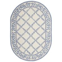Safavieh Chelsea Wool 4-Foot 6-Inch x 6-Foot 6-Inch Oval Rug in Ivory and Light Blue