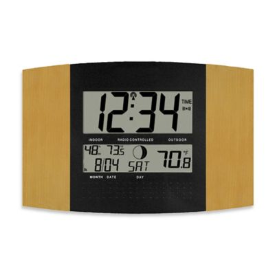 la crosse technology atomic digital wall clock with temperature and moon phase in oakblack