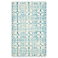 Safavieh Dip Dye Clover 5-Foot x 8-Foot Area Rug in Ivory/Turquoise
