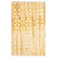 Safavieh Dip Dye Clover 6-Foot x 9-Foot Area Rug in Ivory/Gold