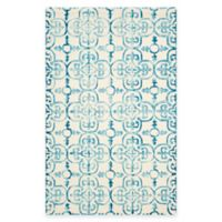 Safavieh Dip Dye Clover 6-Foot x 9-Foot Area Rug in Ivory/Turquoise