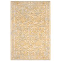Safavieh Evoke Collection Jade 5-Foot 1-Inch x 7-Foot 6-Inch Area Rug in Ivory/Gold