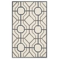 Safavieh Four Seasons Logan 5-Foot x 8-Foot Indoor/Outdoor Area Rug in Ivory/Black