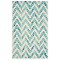 Safavieh Dip Dye Chevron 6-Foot x 9-Foot Hand-Tufted Wool Area Rug in Ivory/Turquoise