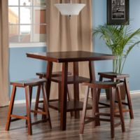 The Winsome Trading Orlando 5-Piece High Table and Saddle Seat Stool Pub Set in Walnut
