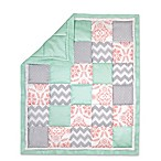 The Peanut Shell® Dot Patchwork Quilt in Coral/Mint