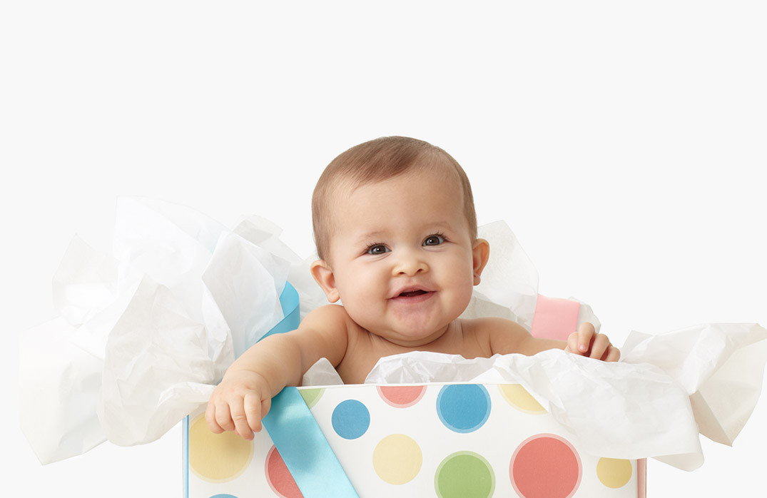 Baby coming out of gift bag