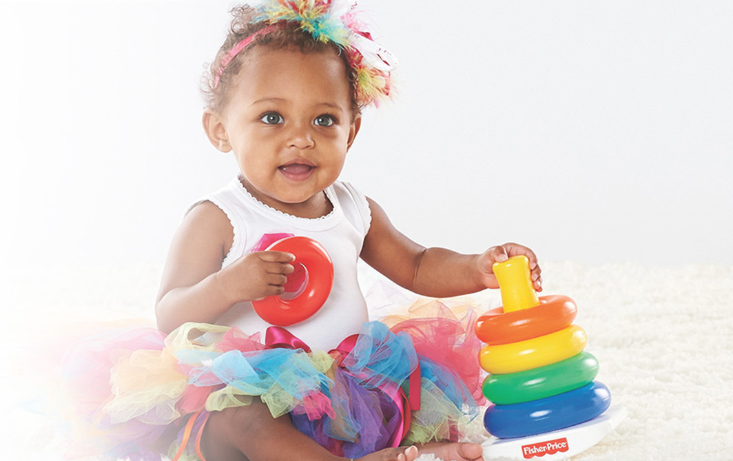 Baby girl with Fisher Price Toy
