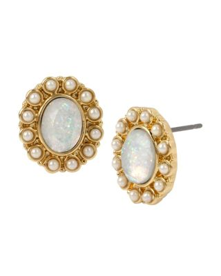 "Tiny pearl accents surround a stunning glitter stone on these elegant studs. The gold-tone hardware adds a luxurious, vintage twist to these modern studs. Gold tone glitter stone stud earring with pearl accents Post Back Antique gold tone hardware Metal/glass/acrylic Length: 0.6"" Width: 0.5"" Pearl: acrylic Pearl size: 2mm"