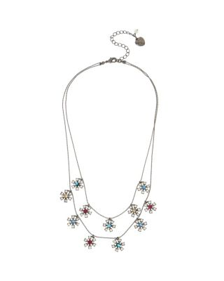 "This stunning illusion necklace features rows of floating daisies. This feminine piece will give your look a soft, flowery feel. Hematite-tone necklace with multi-colored stone daisies Lobster claw Hematite Metal/glass Length: 16""-18"" + 3"" Ext Frontal Drop 1.5"""