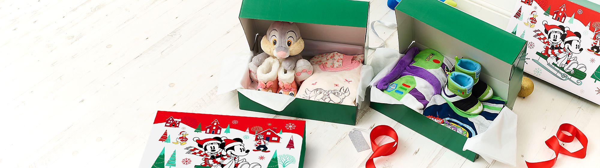 Confezioni regalo e  borse shopper Dai un'occhiata alla nostra scelta di confezioni regalo e borse shopper con Topolino, Minnie e molti altri personaggi.