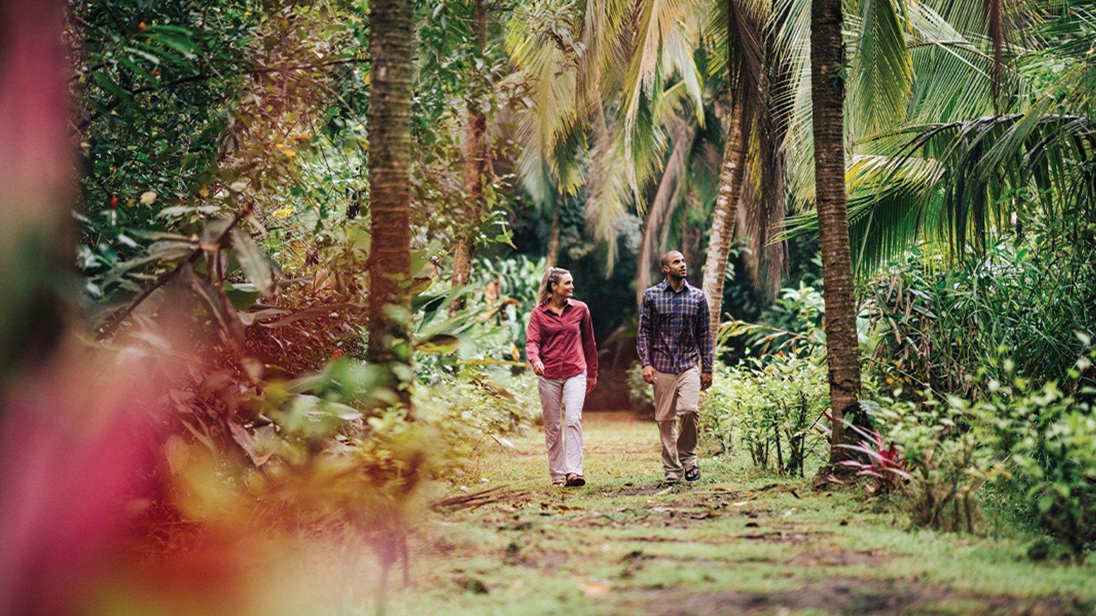 man and woman hiking wearing long sleeve hiking shirts and pants