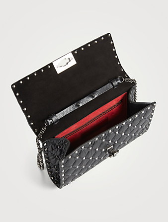 37d6d6bc5 ... VALENTINO GARAVANI Rockstud Spike Cracked Leather Clutch Bag Women's  Black