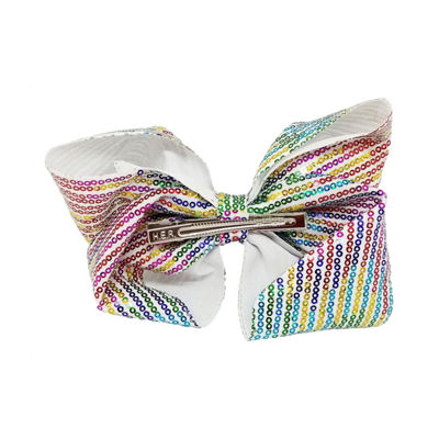 JoJo Siwa Signature White Bow With Rainbow Rhinestone Stripes.
