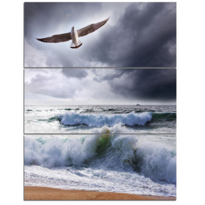 Designart Large Seagull Over Stormy Waves Modern Beach Triptych Canvas Art Print