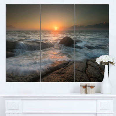 Designart Lashing Sea Waves At Sunset Beach PhotoCanvas Print - 3 Panels