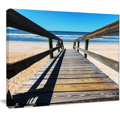 Designart Long Boardwalk Into Blue Seashore Seashore Canvas Art Print