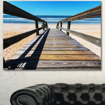 Designart Long Boardwalk Into Blue Seashore Seashore Canvas Art Print - 3 Panels