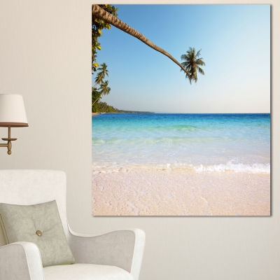 Designart Long Coconut Palm Into The Sea SeascapeCanvas Art Print
