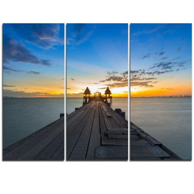 Designart Long Wood Pier Leading To Colorful SeaSea Bridge Triptych Canvas Art Print