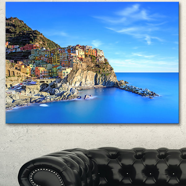 Designart Manarola Village In Rocks And Sea BeachPhoto Canvas Print - 3 Panels