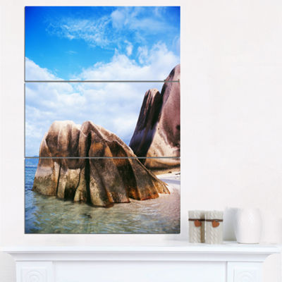 Designart Massive Rocks In Seychelles Beach ModernSeascape Triptych Canvas Artwork