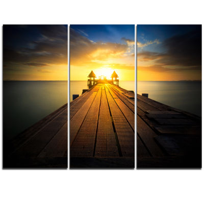 Designart Massive Wood Pier To Sun At Evening PierSeascape Triptych Canvas Art Print
