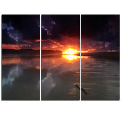 Designart Mirrored Sun In Cloudy Dark Seashore Seashore Triptych Canvas Art Print