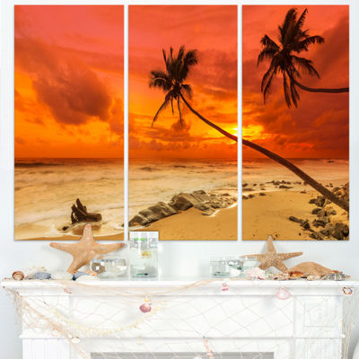 Designart Palms Silhouettes Bent To Seashore ExtraLarge Seashore Triptych Canvas Art