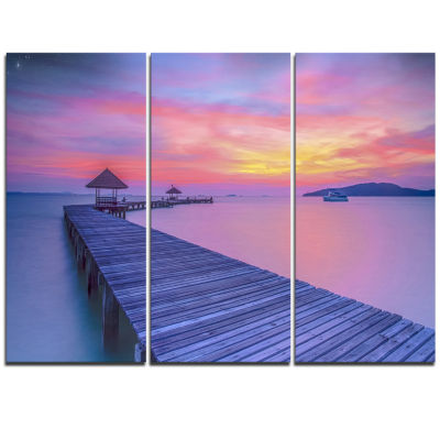 Designart Purple Tinged Wood Bridge And Beach PierSeascape Triptych Canvas Art Print