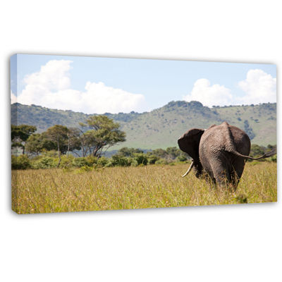 Designart Retreating Elephant In Savannah Extra Large African Canvas Art Print