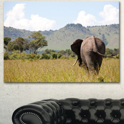 Designart Retreating Elephant In Savannah Extra Large African Canvas Art Print - 3 Panels