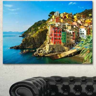 Designart Riomaggiore Village Rocky Beach SeascapeCanvas Art Print - 3 Panels