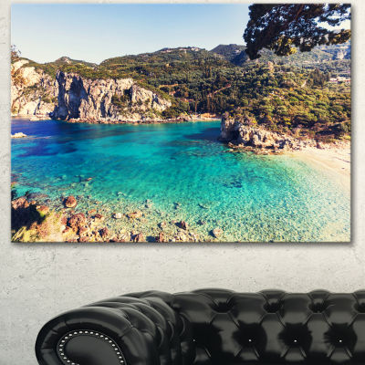 Designart Rocky Beach With Turquoise Water Beach Photo Canvas Print - 3 Panels