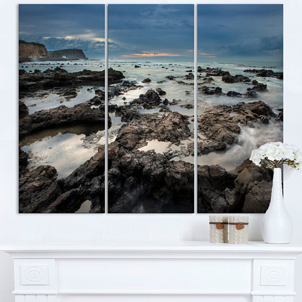 Designart Rocky Seashore With Blue Sky Over LargeSeashore Triptych Canvas Print