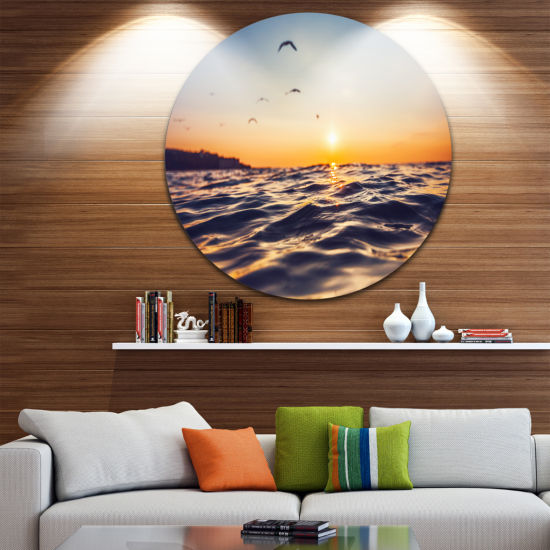 Design Art Orange Tinged Sea Waters at Sunrise Beach Photo Metal Circle Wall Art