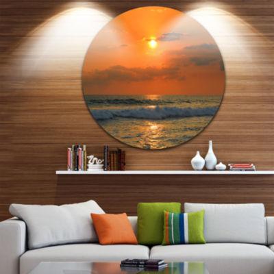Design Art Orange Tinged Tropical Sunset and WavesBeach Photo Metal Circle Wall Art