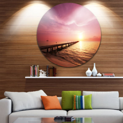 Design Art Long Boardwalk into Sunset Sea Bridge Metal Circle Wall Art