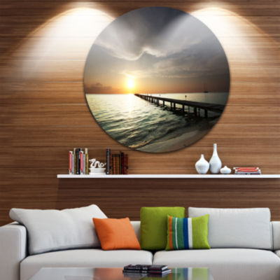Design Art Long Boardwalk in the Cloudy Dark Sea Bridge Metal Circle Wall Art