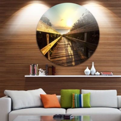 Design Art Wood Boardwalk into the Sunset Sea Bridge Metal Circle Wall Art