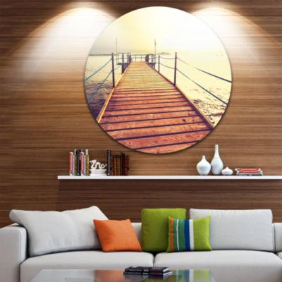 Design Art Brown Wooden Boardwalk to the Sea Bridge Metal Circle Wall Art