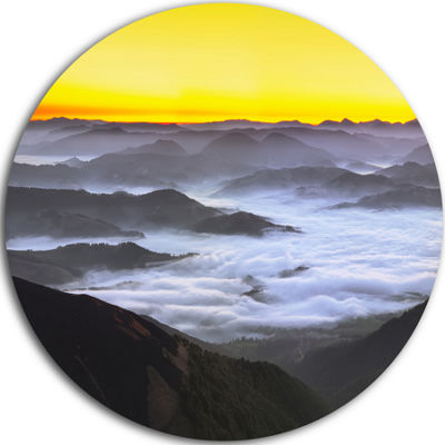 Design Art Yellow Sky and Foggy Mountains Landscape Metal Circle Wall Art