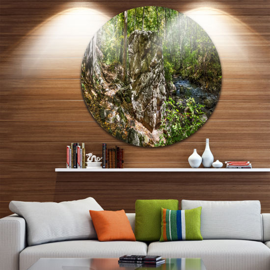 Design Art Huge Rock in Black River Shore Landscape Metal Circle Wall Art