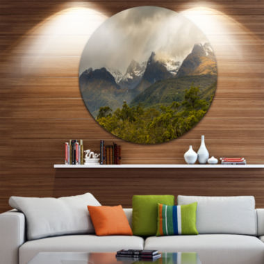 Design Art Green Mountains under Stormy Clouds Landscape Metal Circle Wall Art