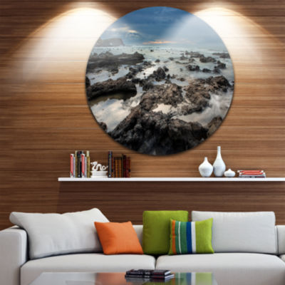 Design Art Rocky Seashore with Blue Sky Over LargeSeashore Metal Circle Wall Art